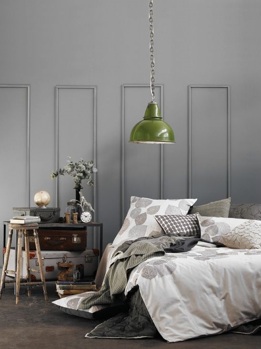 green industrial light in grey bedroom