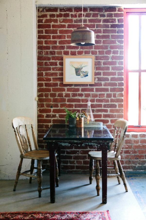 Dining area with exposed brick feature wall