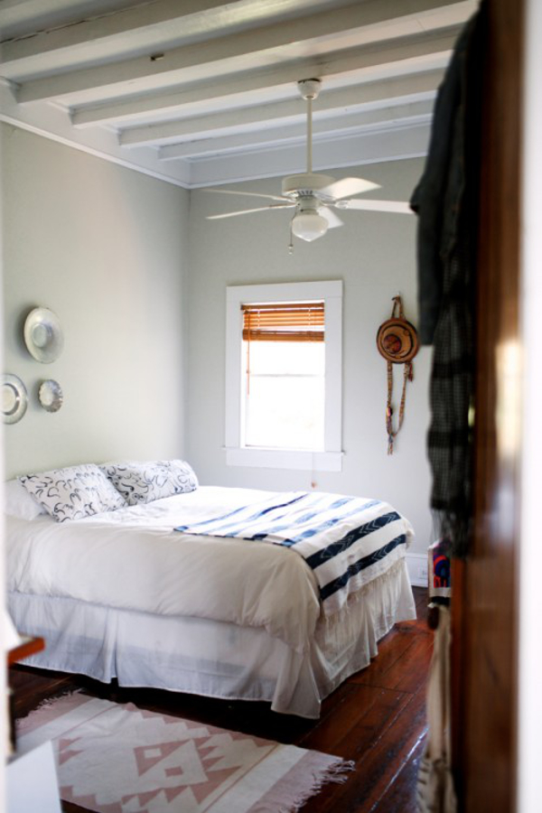 white and blue bedroom in Harper Poe's home