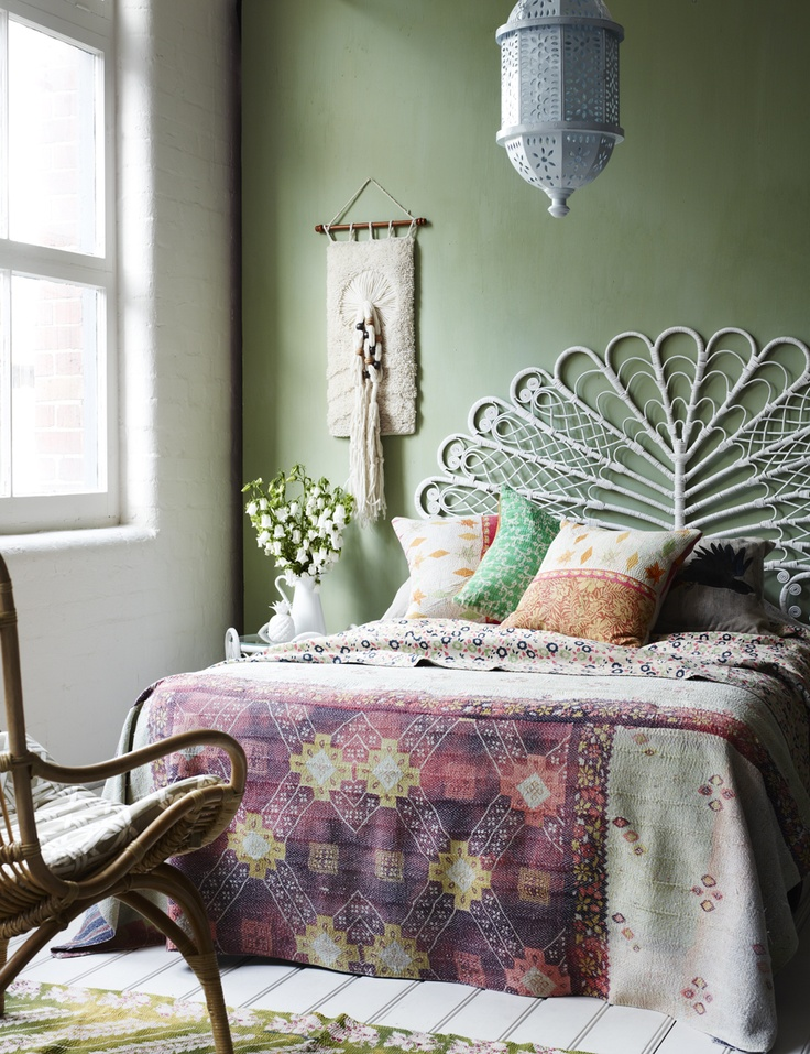 Feminine bohemian bedroom with kantha quilt
