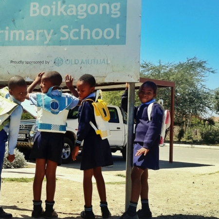 Pupils wearing solar schoolbags in South Africa