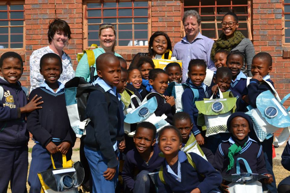 School children with solar schoolbags