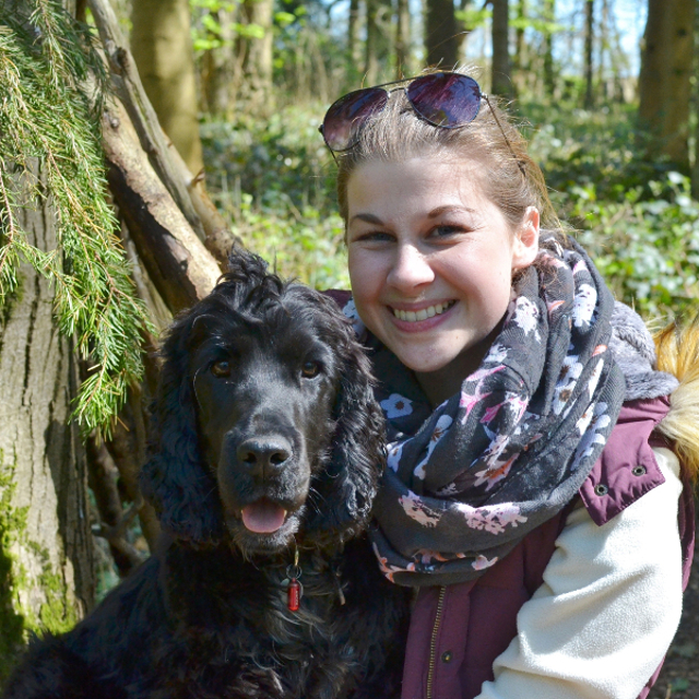 Kimba the hearing dog with Bethan woodland