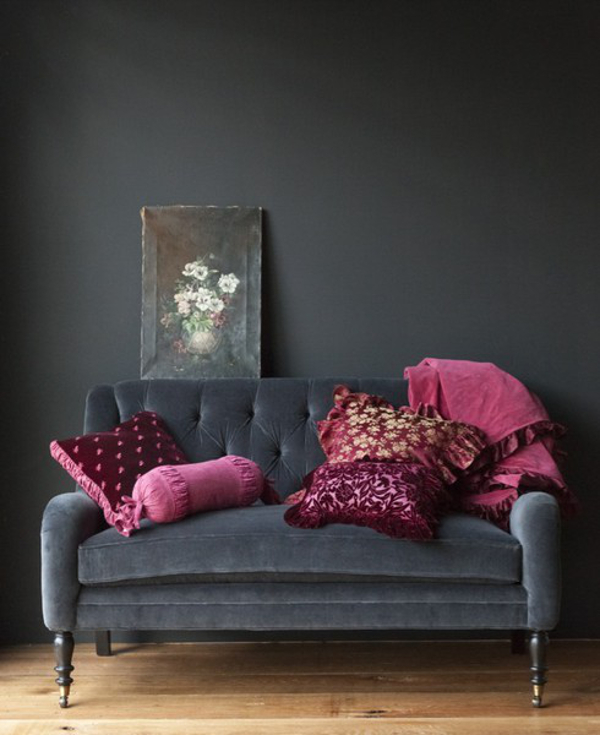 Charcoal grey living room with pink accent colour