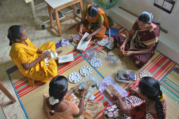 Women making fair trade jewellery for Decorator's Notebook